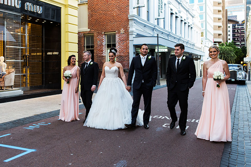 perth wedding photography perth city wedding image of bridal party walking in city
