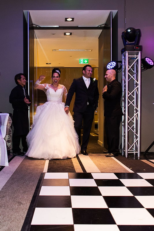 perth wedding photography perth city wedding image of bride and groom walking into reception