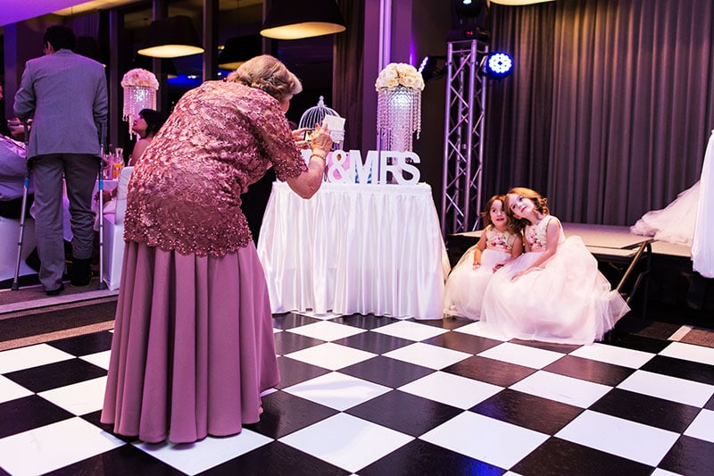 perth wedding photography perth city wedding image of grandma taking photo of flower girls