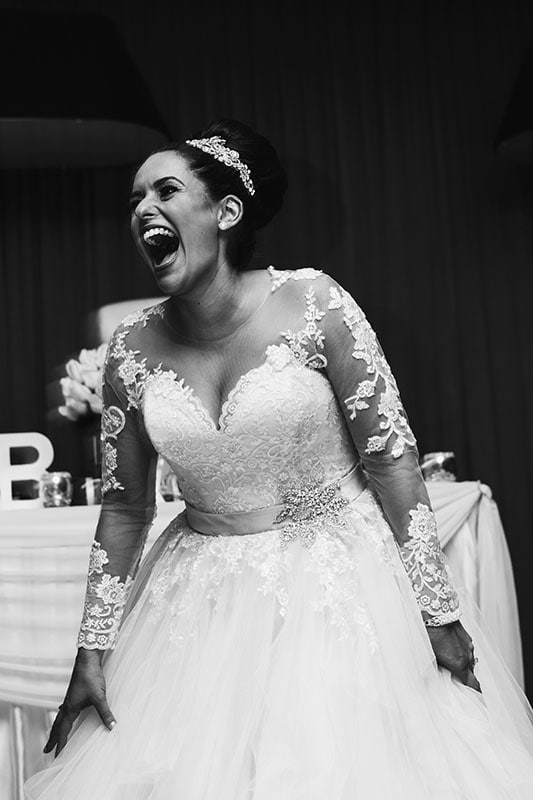 perth wedding photography perth city wedding image of bride laughing at receptio
