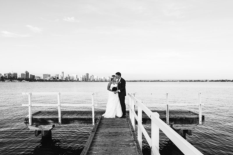wedding photographer perth perth wedding image of bride and groom kissing on jetty