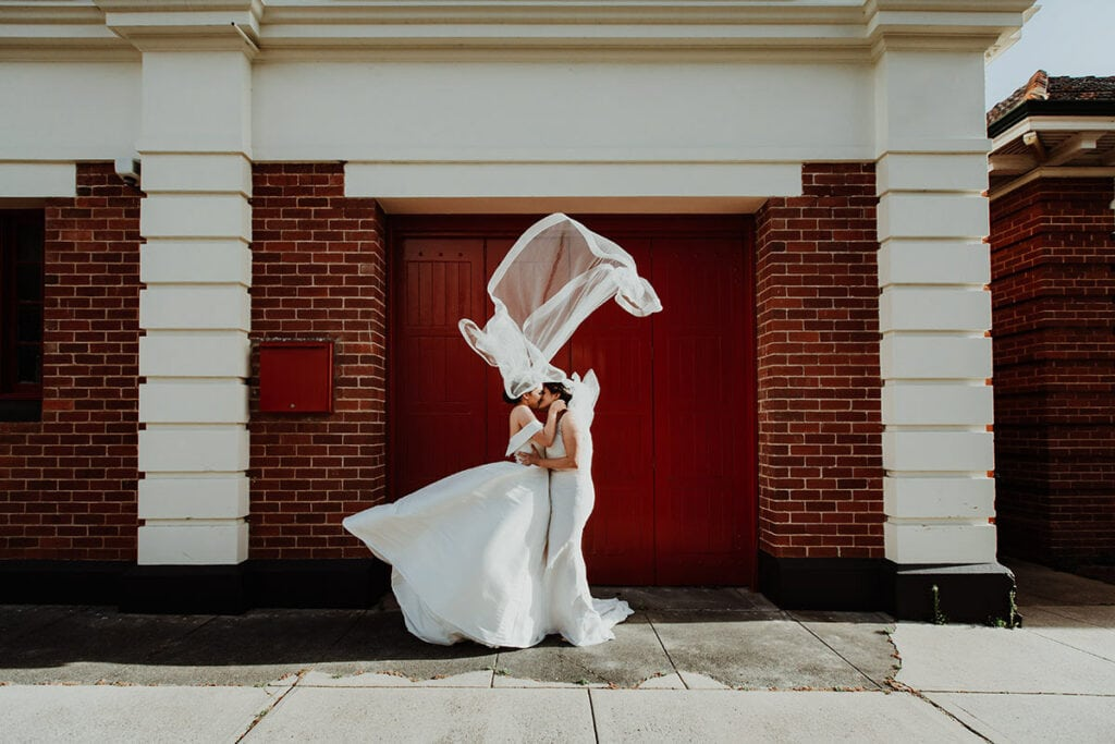 two brides kissing in the wind at perth same sex wedding